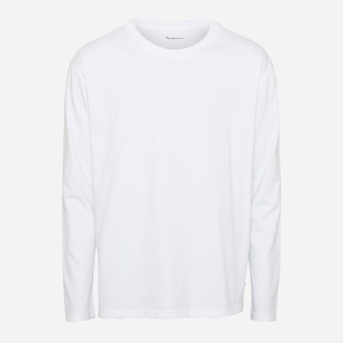 Walnut från Knowledge Cotton Apparel är tillverkad av 100% ekologisk bomull. Rundhalsad krage med tunna muddar i midja samt ärmslut.Denperfekta mittemellan-tröjan som ger ett elegant &avslappnat uttryck.